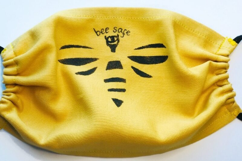 yellow mask with a bee pringt and the words bee safe