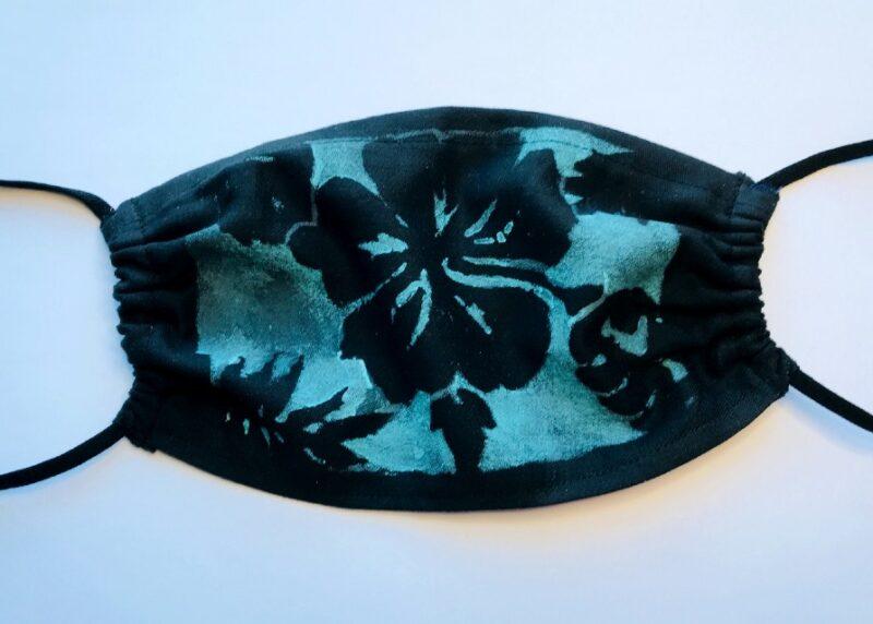 Blue mask with black flower design