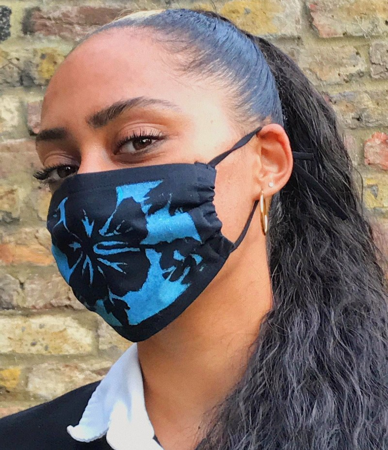 Woman wearing a blue and black mask