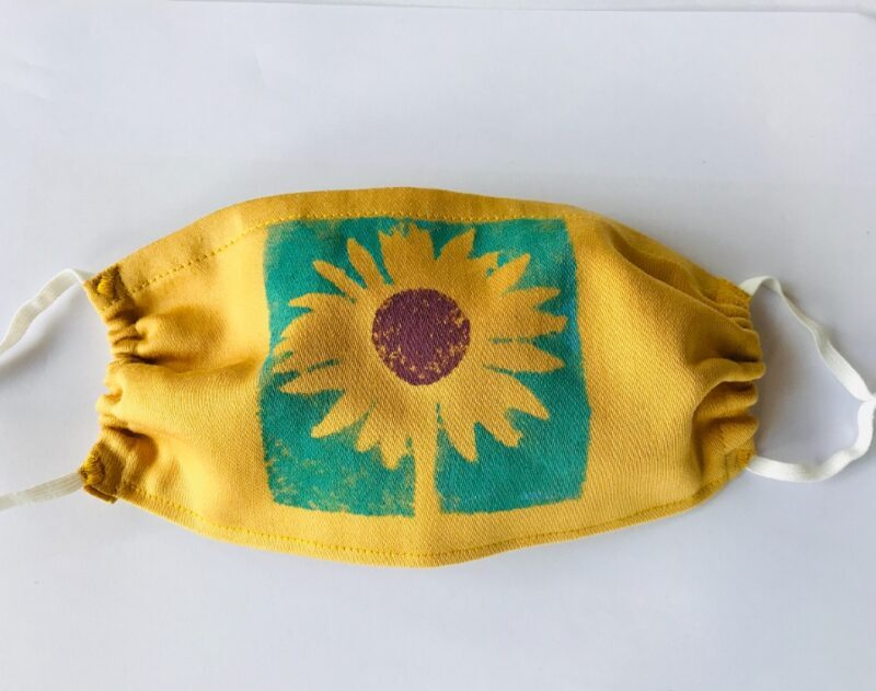 Sunflower design mask on yellow cotton
