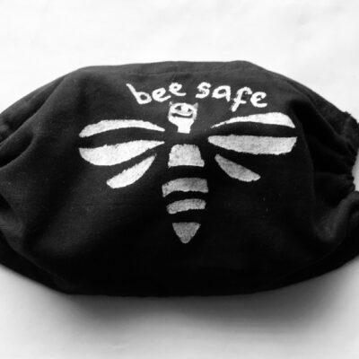 Hand printed white bee on black mask