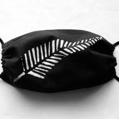 Hand printed white fern on black mask