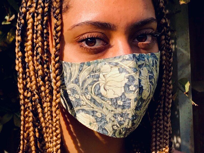 Woman in William Morris Pimpernel Cream mask
